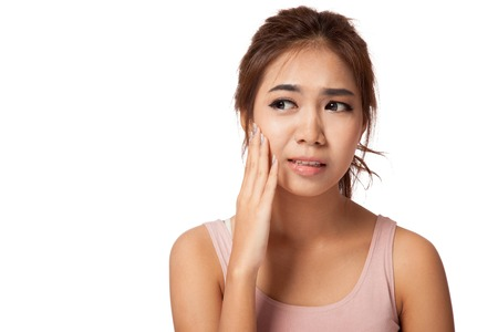 affliction: Pretty Asian girl has toothache  isolated on white
