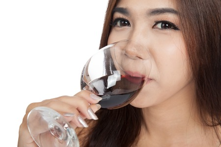 Close up of Beautiful Asian woman drink red wine  isolated on white background photo