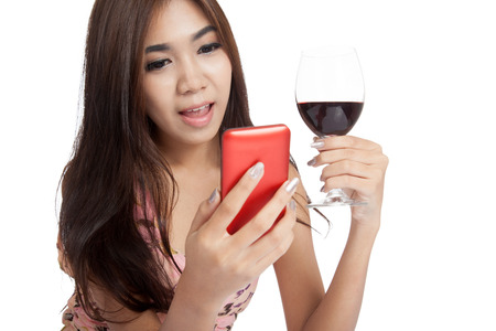 Beautiful Asian woman smile with mobile phone and red wine  isolated on white background photo