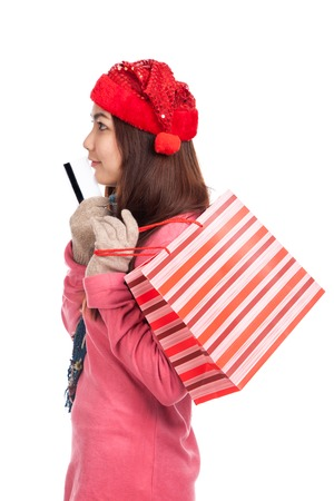 Asian girl with red christmas hat ,credit card and shopping bag  isolated on white background photo