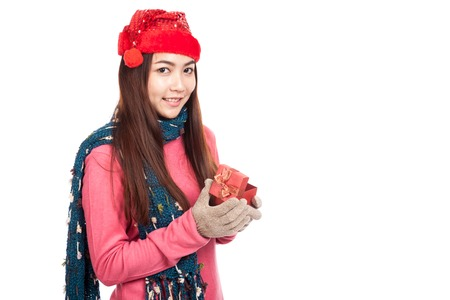 Asian girl with red christmas hat smile open gift box  isolated on white background photo