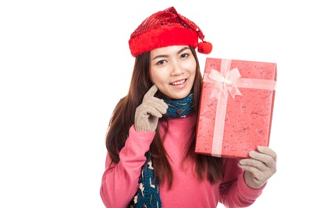 Asian girl with red christmas hat show a gift box  isolated on white background photo