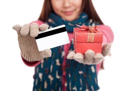 hat new year happy new year festive: Asian girl with winter dress,credit card and gift box  isolated on white background Stock Photo