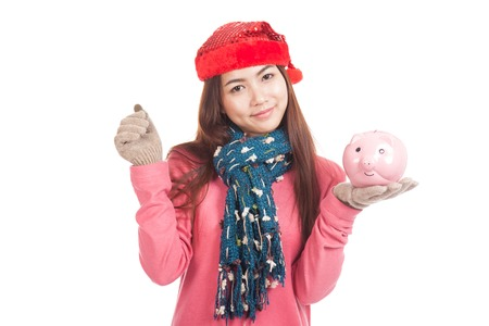 Asian girl with red christmas hat ,coin and piggy bank  isolated on white background photo