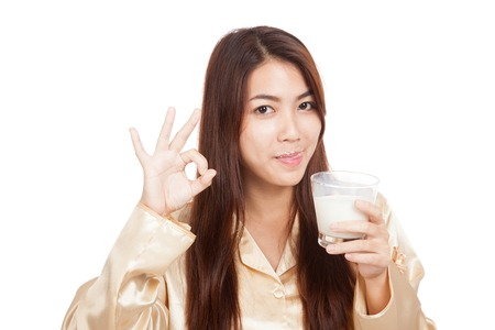 Asian woman drink milk  licking her lip show OK  isolated on white background photo