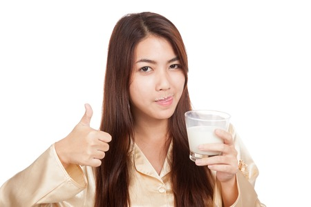 Asian woman drink milk  licking her lip show thumbs up  isolated on white background photo