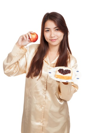 Asian woman with apple , bread and heart shape berry jam  isolated on white background photo