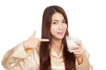 Asian woman  licking her lip point to glass of milk  isolated on white background photo