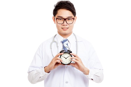 Asian male doctor with a clock  isolated on white background  isolated on white background photo