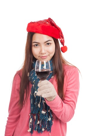 Asian girl with red christmas hat and a glass of wine  isolated on white background photo