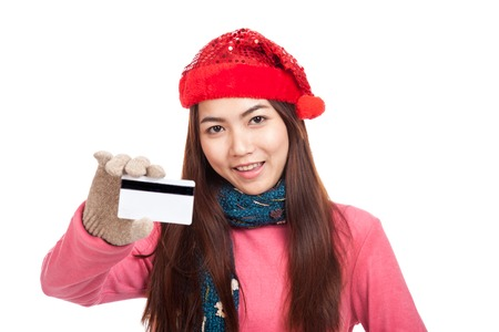Asian girl with red christmas hat smile show credit card  isolated on white background photo