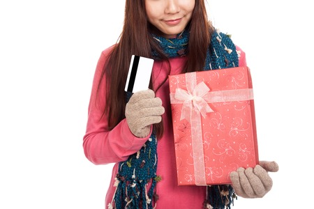 Asian girl with winter dress,credit card and gift box  isolated on white background photo