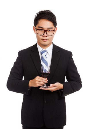 Asian businessman with glass of red wine  isolated on white background photo