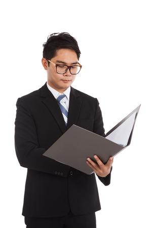 Asian businessman working hold folder  isolated on white background photo