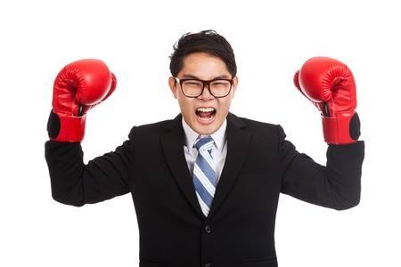 satisfy: Asian businessman satisfy with red boxing glove  isolated on white background Stock Photo