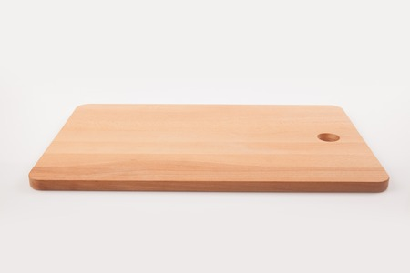 Wooden chopping board on white background