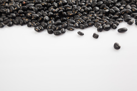 black gram: Black beans at top border with white copy space Stock Photo
