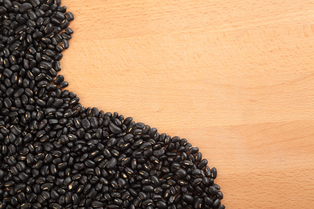 black gram: Black beans on wood table with copy space Stock Photo