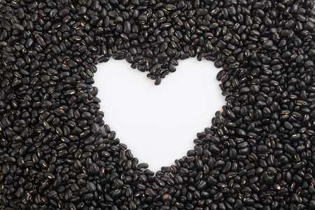 black gram: Black beans with white heart shape space