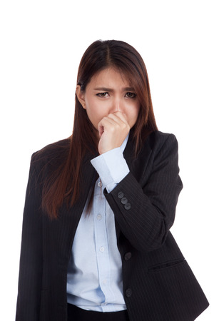 stench: Young Asian businesswoman holding her nose because of a bad smell  isolated on white background