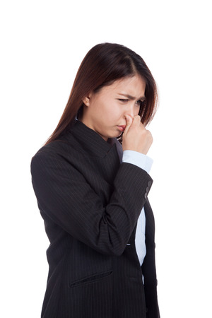bad breath: Young Asian businesswoman holding her nose because of a bad smell  isolated on white background