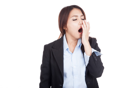 Tired young Asian businesswoman yawn  isolated on white background