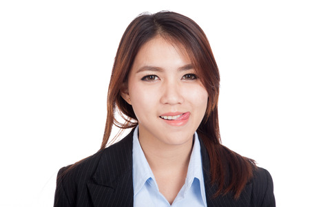 Young Asian businesswoman smile with her tongue out  isolated on white background Foto de archivo