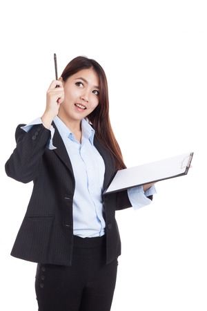 jot: Young Asian businesswoman with clipboard  get an idea  isolated on white background