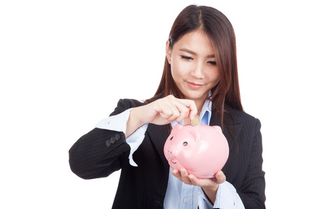 white piggy bank: Young Asian businesswoman with a coin and piggy bank  isolated on white background Stock Photo