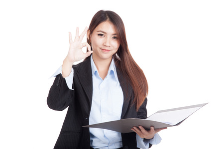 ok sign: Young Asian businesswoman show OK with folder  isolated on white background