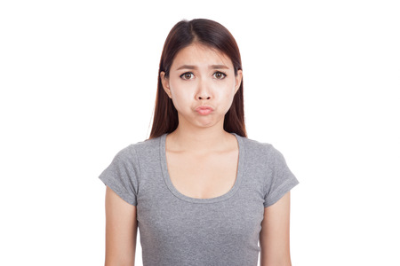 bad mood: Young Asian woman is in bad mood  isolated on white background