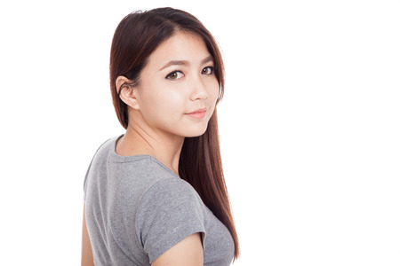 turn back: Young Asian woman turn back to camera  isolated on white background Stock Photo