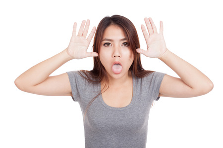 Funny young Asian woman sticking out tongue  isolated on white background Stock Photo