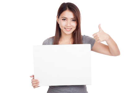Young Asian woman thumbs up with blank sign  isolated on white background