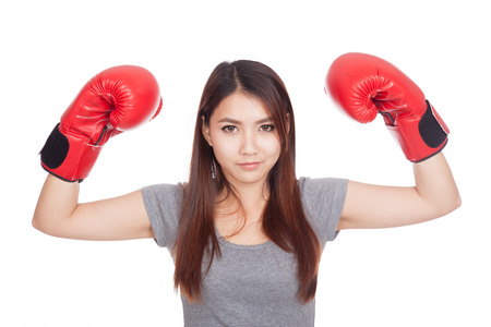 Young Asian woman with red boxing glove  isolated on white background