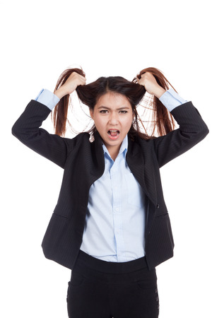 Stressed young Asian businesswoman is going crazy pulling her hair  isolated on white background photo