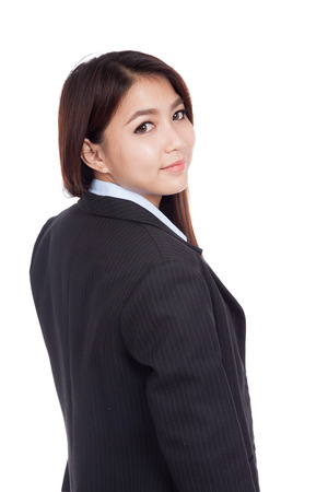 turn back: Young Asian businesswoman turn back look at camera  isolated on white background Stock Photo