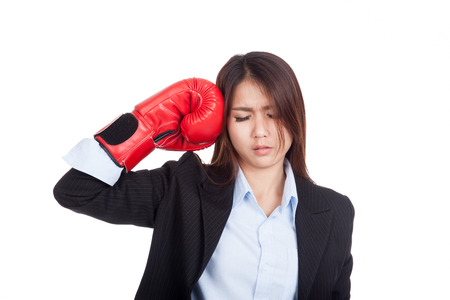 mood moody: Young Asian businesswoman with boxing glove  isolated on white background