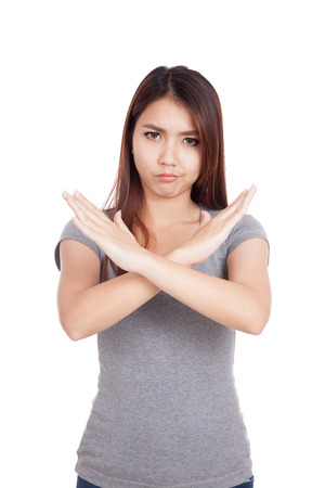 Young Asian woman gesturing stop, cross her arms  isolated on white background