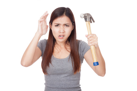 fed up: Angry young Asian woman with hammer  isolated on white background