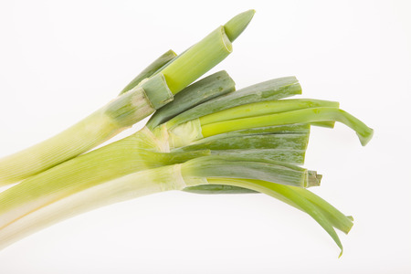 leeks: Three fresh Leeks on white background