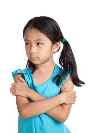 bad mood: Little asian girl sulk, in bad mood  isolated on white background Stock Photo