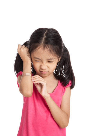 Little asian girl  hurt with bandage on her arm  isolated on white background Reklamní fotografie