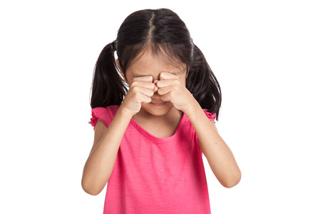 mood moody: Little asian girl is sad and cry  isolated on white background