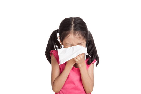 Little asian girl sneeze with napkin paper  isolated on white background