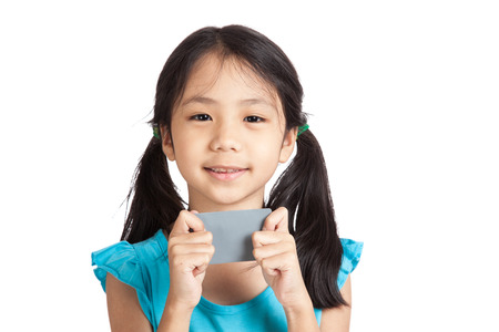 Little asian girl smile with a blank gray card  isolated on white background