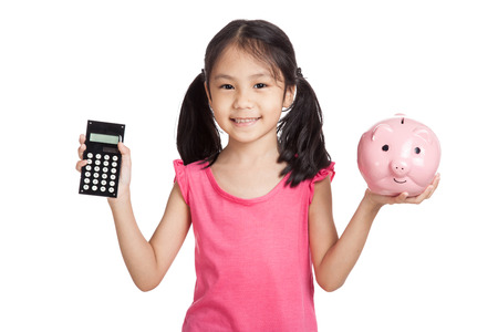 Little asian girl  with a calculator and piggy bank  isolated on white background