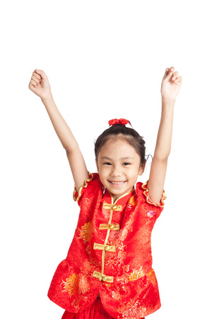 Asian girl in chinese cheongsam dress put her hands up  isolated on white background