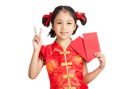 red envelope: Asian girl in chinese cheongsam dress show vtctory sign with red envelope  isolated on white background