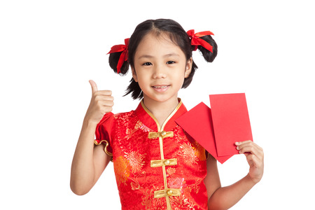 red envelope: Asian girl in chinese cheongsam dress thumbs up  with red envelope  isolated on white background Stock Photo